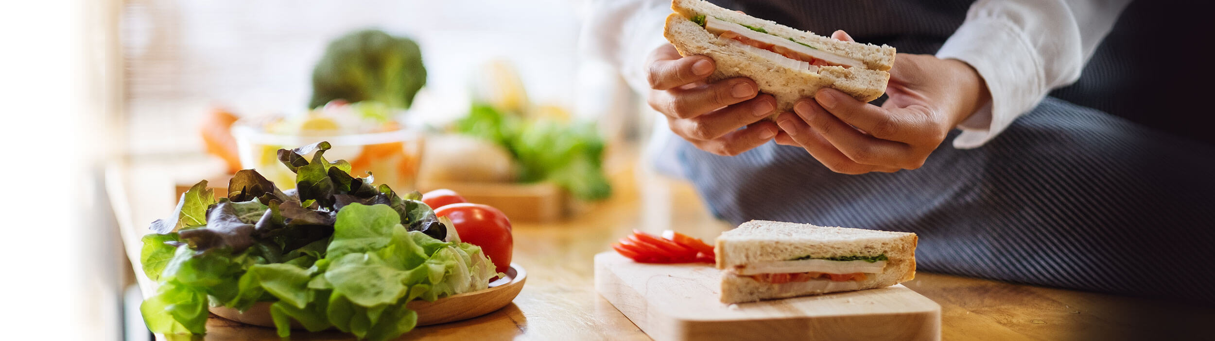 hands holding a sandwich - delivery services in PA - Novick Corporation